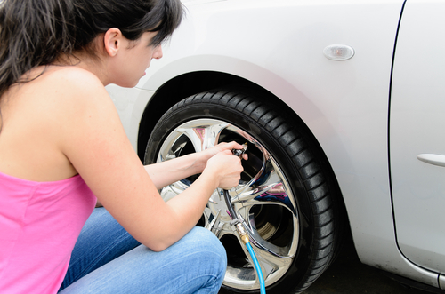 women checking tire